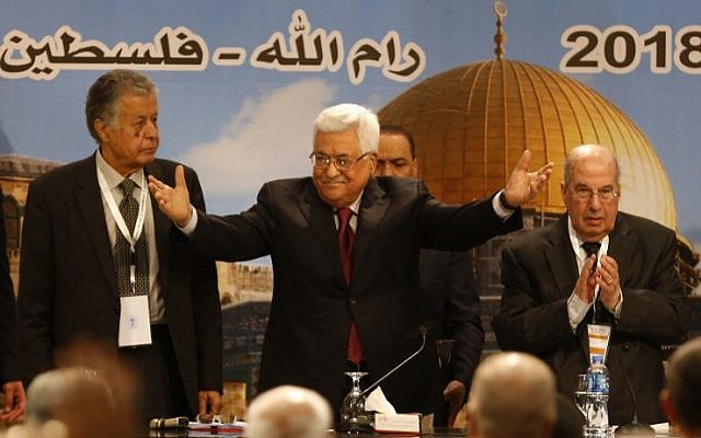 Illustrative: Palestinian Authority President Mahmoud Abbas gestures as he chairs a Palestinian National Council meeting in Ramallah on April 30, 2018. (AFP/ABBAS MOMANI)