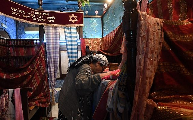 A Tunisian Jewish woman is seen in the Ghriba synagogue in the Tunisian resort island of Djerba on May 1, 2018 on the eve of the annual Jewish pilgrimage to the synagogue. (AFP PHOTO / FETHI BELAID)