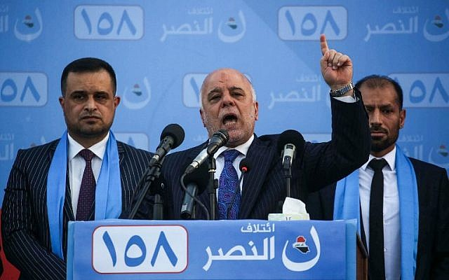 Iraqi Prime Minister Haider al-Abadi (C) speaks as he presents candidates running on his list during an electoral campaign rally in the holy Iraqi city of Karbala on May 4, 2018.  (AFP Photo/Mohammed Sawaf)