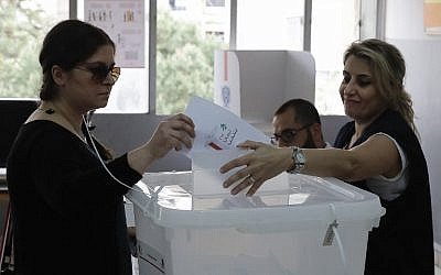 A Lebanese woman casts her vote at a polling station in Ain al-Rummaneh on the southern outskirts of Beirut on May 6, 2018,  as the country votes in its first parliamentary elections in nine years (AFP PHOTO / JOSEPH EID)