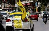 Hezbollah supporters tour the city of Nabatieh in southern Lebanon on May 6, 2018, as the country voted in its first parliamentary elections in nine years. (AFP Photo/Mahmoud Zayyat)