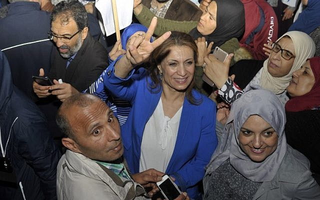 Tunisian Ennahdha party member Souad Abderrahim (C) celebrates after winning the municipal elections in front of the movement's headquarters in Tunis late on May 6, 2018. (AFP PHOTO / SOFIENNE HAMDAOUI)