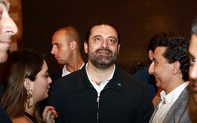 Lebanese Prime Minister Saad Hariri greets supporters in his house in downtown Beirut while waiting for the electoral results on May 6, 2018. (AFP PHOTO / ANWAR AMRO)