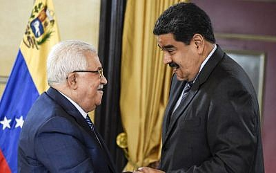 Venezuelan President Nicolas Maduro greets Palestinian Authority President Mahmoud Abbas, during a meeting at the Miraflores presidential palace in Caracas on May 7, 2018. (AFP PHOTO / JUAN BARRETO)