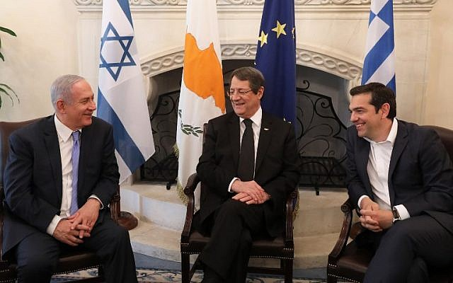Cypriot President Nicos Anastasiades center, Prime Minister Benjamin Netanyahu left, and Greek Prime Minister Alexis Tsipras talk during a meeting at the Presidential Palace in Nicosia, on May 8, 2018.  (YIANNIS KOURTOGLOU/AFP)