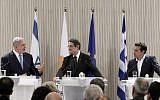 Prime Minister Benjamin Netanyahu (L) speaks during a press conference with Cypriot President Nicos Anastasiades (C) and Greek Prime Minister Alexis Tsipras (R), at the Presidential Palace in the Cypriot capital Nicosia on May 8, 2018. (AFP PHOTO / POOL / YIANNIS KOURTOGLOU)
