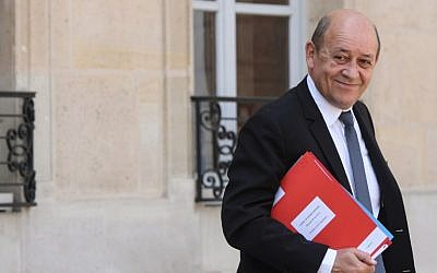 French Foreign Affairs Minister Jean-Yves Le Drian leaves the Elysee Presidential palace in Paris, on May 9, 2018, after the weekly cabinet meeting.  (AFP / CHRISTOPHE ARCHAMBAULT)