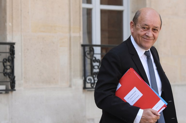 French Foreign Affairs Minister Jean Yves Le Drian leaves the Elysee Presidential palace in Paris