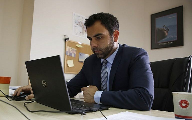 Human Rights Watch's Israel and Palestine director Omar Shakir works at his office in the West Bank city of Ramallah