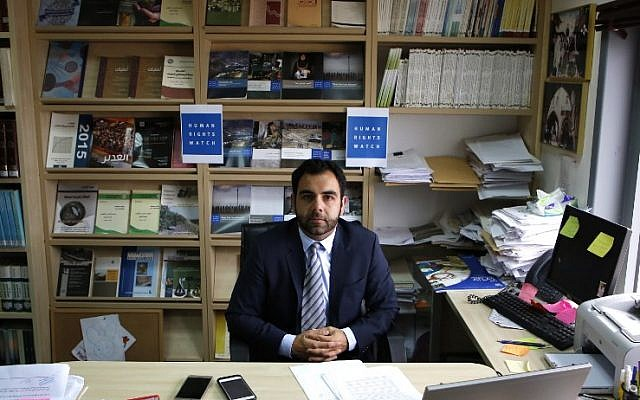 Human Rights Watch's Israel and Palestine director Omar Shakir, a US citizen, sits in his office in the West Bank city of Ramallah, May 9, 2018. (ABBAS MOMANI/AFP)
