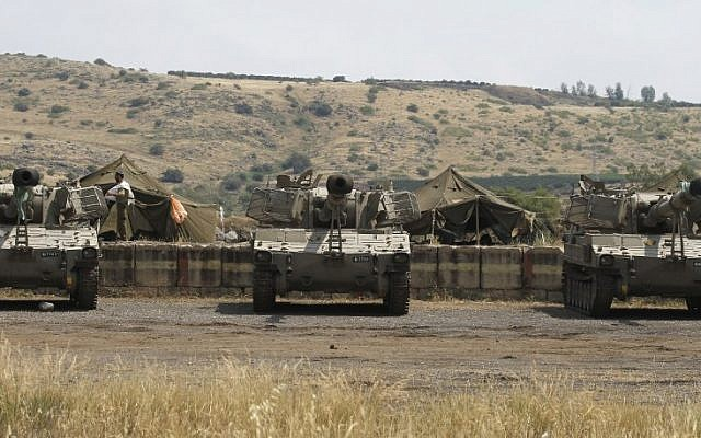An Israeli artillery unit takes position near the Syrian border on the Golan Heights on May 9, 2018. (Jalaa Marey/AFP)