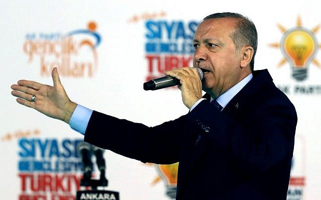 Turkish President Recep Tayyip Erdogan addresses the crowd during the congress of the ruling Justice and Development Party's (AKP) Ankara youth branches at the Ankara Sports Hall in Ankara, Turkey, on May 11, 2018. (AFP Photo/Adem Altan)