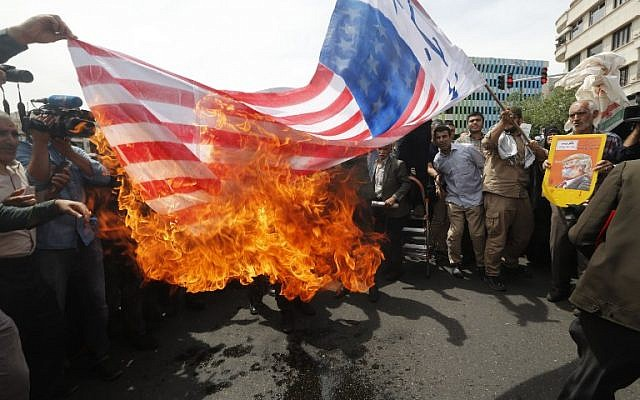 Iranians set fire to a makeshift US flag during a demonstration after Friday prayers in the capital Tehran on May 11, 2018. (AFP PHOTO / STRINGER)