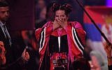 Israel's singer Netta Barzilai aka Netta reacts after winning the final of the 63rd edition of the Eurovision Song Contest 2018 at the Altice Arena in Lisbon, on May 12, 2018. (AFP/Francisco LEONG)