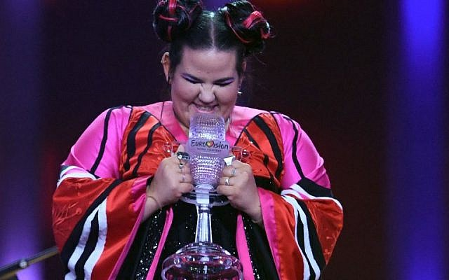 Israel's singer Netta Barzilai celebrates with the trophy after winning the final of the 63rd edition of the Eurovision Song Contest 2018 at the Altice Arena in Lisbon, on May 12, 2018. (AFP PHOTO / Francisco LEONG)