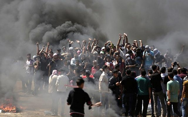 Palestinian demonstrators burn tires near the Gaza Israel border east of Gaza City