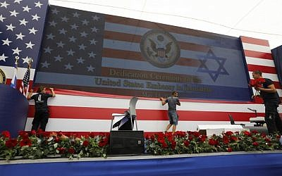 Embassy staff prepare the stage ahead of the inauguration of the US embassy in Jerusalem on May 14, 2018. (AFP PHOTO / Menahem KAHANA)