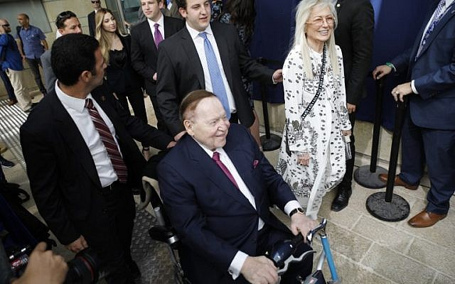 Chairman and chief executive officer of the Las Vegas Sands Corporation Sheldon Adelson, center, and his wife Miriam arrive ahead of the inauguration of the US embassy in Jerusalem on May 14, 2018. (AFP/Menahem KAHANA)