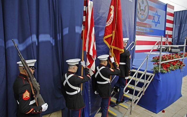 Members of the US honor guard carry flags onto the stage during the opening of the US Embassy in Jerusalem, on May 14, 2018. (Menahem KAHANA/AFP)