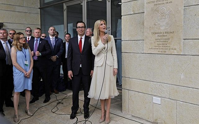 US Treasury Secretary Steve Mnuchin and US President Donald Trump's daughter and adviser Ivanka Trump unveil the inauguration plaque during the opening of the US embassy in Jerusalem on May 14, 2018. (AFP Photo/Menahem Kahana)