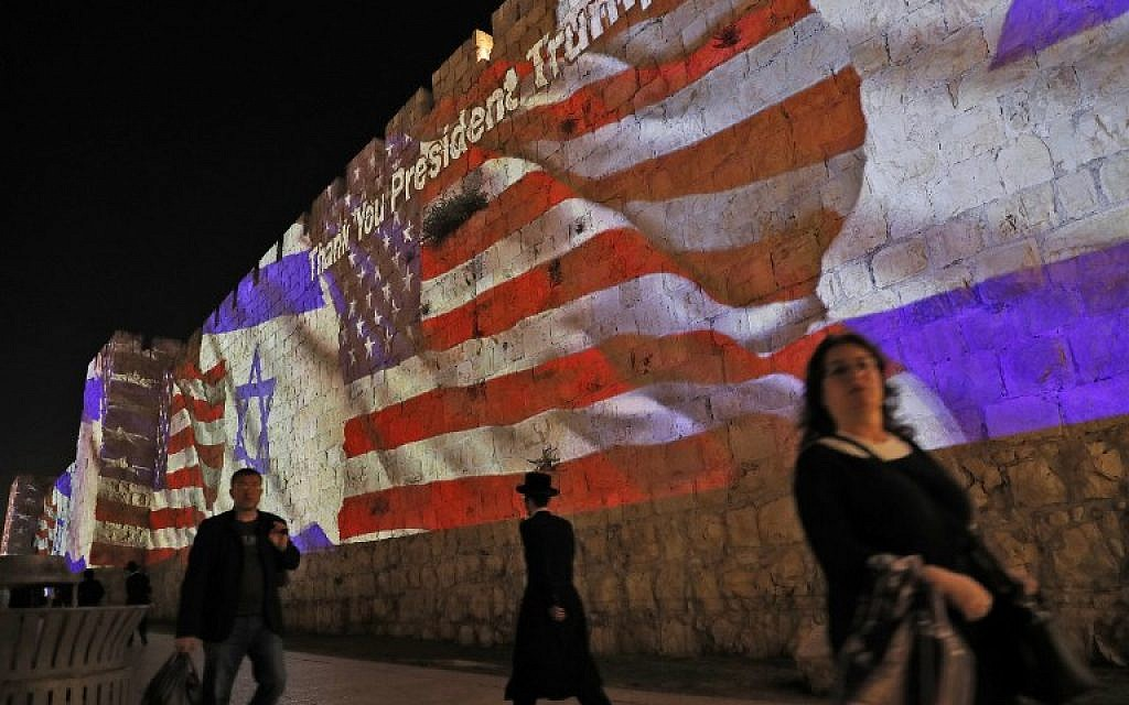 The Israeli and United States flags are projected on the walls of the ramparts of Jerusalem's Old City, to mark the opening of the new US embassy on May 14, 2018.  (AFP/Ahmad GHARABLI)