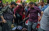 Protesters kick an effigy of Israel's Prime Minister Benjamin Netanyahu as they shout slogans in Diyarbakir, Turkey, on May 15, 2018. (AFP  / ILYAS AKENGIN)