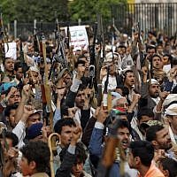 Yemeni Houthi supporters take part in a demonstration against the US's decision to move its embassy in Israel from to Jerusalem, in the capital Sanaa, on May 15, 2018. (AFP PHOTO / MOHAMMED HUWAIS)