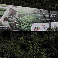A graffiti referring to the FARC 36 front is seen on a billboard of the Ituango Dam, close to Ituango municipality, Antioquia Department, Colombia, taken on May 12, 2018. (AFP/ Joaquin SARMIENTO)