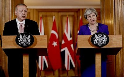 Britain's Prime Minister Theresa May and Turkey's President Recep Tayyip Erdogan attend a joint press conference following their meeting inside 10 Downing Street in central London on May 15, 2018. (AFP/ POOL / Matt Dunham)