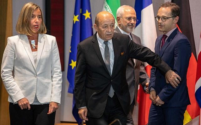 Iran's Foreign Minister Mohammad Javad Zarif (2nd R), France's Foreign Minister Jean-Yves Le Drian (2nd L), Germany Foreign Minister Heiko Maas (R), EU High Representative for Foreign Affairs Federica Mogherini and Britain's Foreign Secretary arrive for a meeting of EU/E3 with Iran at the EU headquarters in Brussels on May 15, 2018.  (AFP PHOTO / POOL / Olivier Matthys)