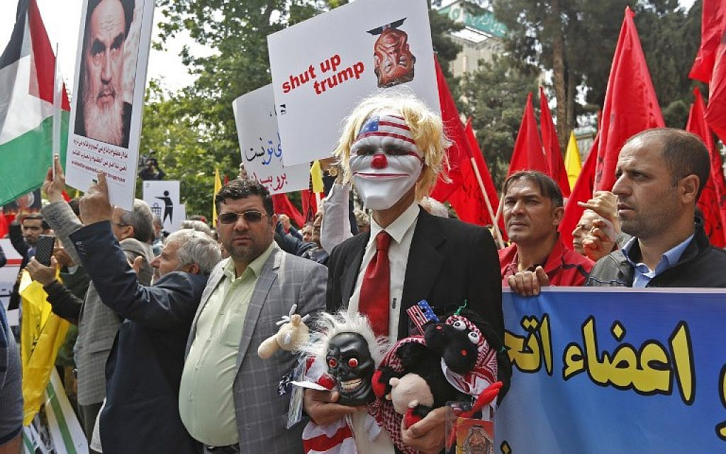 Iranians take part in an anti-US demonstration inside the former US embassy headquarters in the capital Tehran on May 16, 2018. (AFP PHOTO / ATTA KENARE)