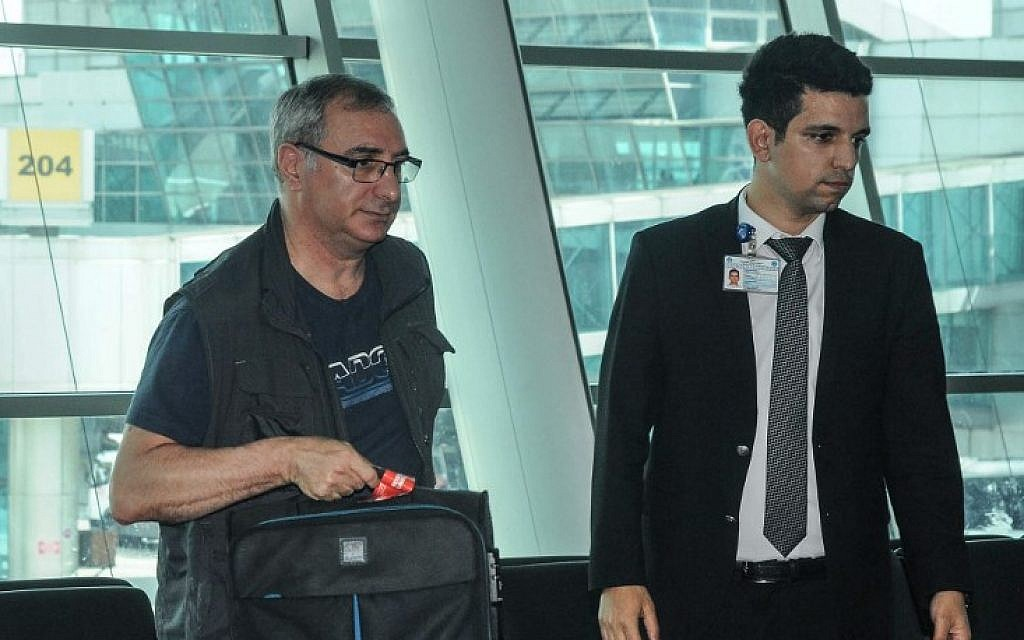 Israeli Ambassador to Turkey Eitan Na'eh (L) holds his luggage at Istanbul Ataturk Airport on May 16, 2018, as he prepares to leave Turkey. (AFP Photo/DHA/Dogan News Agency)