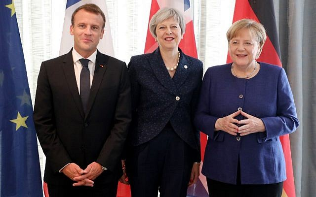 French President Emmanuel Macron, left, British Prime Minister Theresa May, center, and German Chancellor Angela Merkel smile as they pose for photos at the start of an EU-Western Balkans Summit in Sofia, May 17, 2018. (Ludovic MARIN/AFP)