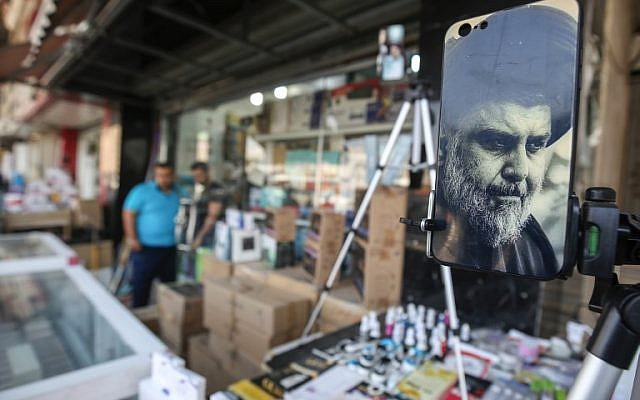 A picture taken on May 17, 2018 shows the face of Iraqi Shiite cleric and leader Muqtada al-Sadr adorning the plastic cover of a cell phone, on display at a peddlar's stall in a market street in the capital Baghdad. (AFP/AHMAD AL-RUBAYE)