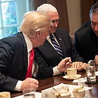 US President Donald Trump speaks (R) with Secretary of State Mike Pompeo as Vice President Mike Pence (C) looks on during a meeting with NATO Secretary General Jens Stoltenberg in the Cabinet Room at the White House in Washington, DC, on May 17, 2018. (AFP PHOTO / NICHOLAS KAMM)