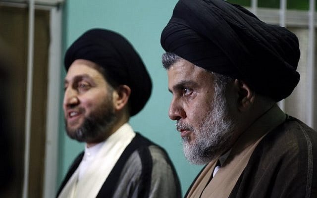 Iraqi Shiite Muslim leader and head of Hikma party Ammar al-Hakim (L) and Shiite cleric Muqtada al-Sadr meet in the Iraqi holy city of Najaf on May 17, 2018. ( AFP PHOTO / Haidar HAMDANI)