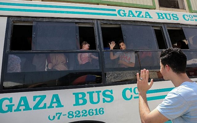 Palestinians wait to travel to Egypt through the Rafah border crossing in the southern Gaza Strip, on May 18, 2018. (AFP Photo/Said Khatib)