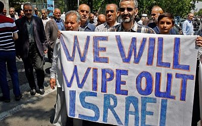 Iranians hold a banner with an anti-Israel message in the capital Tehran on May 18, 2018, as they take part in an anti-US and Israel demonstration after weekly Friday prayers. (AFP/Stringer)