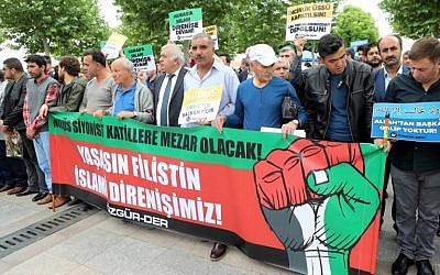 People hold a banner reading 'Long live Palestine-Islam resistance' during an anti-Israel demonstration on May 18, 2018, in front of the Hacibayram mosque in Ankara. (AFP/Adem Altan)