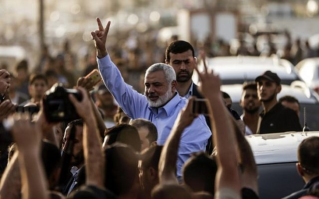Ismail Haniyeh, the head of Hamas, gestures to demonstrators at a a protest camp during clashes with Israeli forces along the border with the Gaza Strip east of Gaza City on May 18, 2018. (AFP Photo/Mahmud Hams)