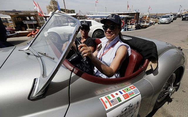 """Drivers take part in the """"Rallye des Graces"""" upon arriving in the Lebanese coastal city of Byblos, north of the capital Beirut, on May 19, 2018, during the first leg of the tour. / AFP PHOTO / JOSEPH EID"""