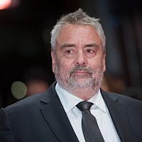 "(FILES) In this file photo taken on February 17, 2018 French director Luc Besson poses on the red carpet upon arrival for the premiere of the film ""Eva"" presented in competition during the 68th Berlinale film festival in Berlin (AFP/ Stefanie Loos)"