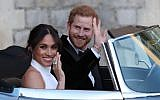 Britain's Prince Harry, Duke of Sussex, (R) and Meghan Markle, Duchess of Sussex, (L) leave Windsor Castle in Windsor on May 19, 2018, in an E-Type Jaguar after their wedding to attend an evening reception at Frogmore House.  (AFP PHOTO / POOL / Steve Parsons)