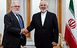 Iran's Foreign Minister Mohammad Javad Zarif (R) shakes hands with the EU's Climate Action and Energy Commissioner Miguel Arias Canete as they meet in the Iranian capital Tehran on May 20, 2018. (AFP Photo/Stringer)