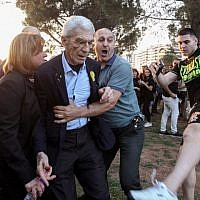 The mayor of Greece''s second city, Thessaloniki, Yiannis Boutaris (C) is helped  after being assulted by suspected far-right members at a rally in Thessaloniki on May 19, 2018. (AFP/Eurokinissi/Eurokinissi)