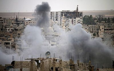 Smoke rises from buildings in a rebel-held neighborhood of Daraa in southern Syria following reported shelling by the Syrian regime on May 22, 2018. (AFP Photo/Mohamad Abazeed)