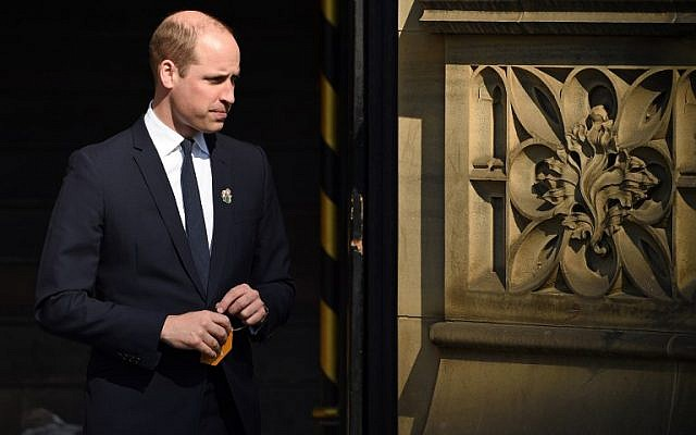 "Britain's Prince William, Duke of Cambridge, carries his message to hang on a ""tree of hope"" as he leaves after attending The Manchester Arena National Service of Commemoration at Manchester Cathedral in central Manchester on May 22, 2018. (AFP/ Oli SCARFF)"
