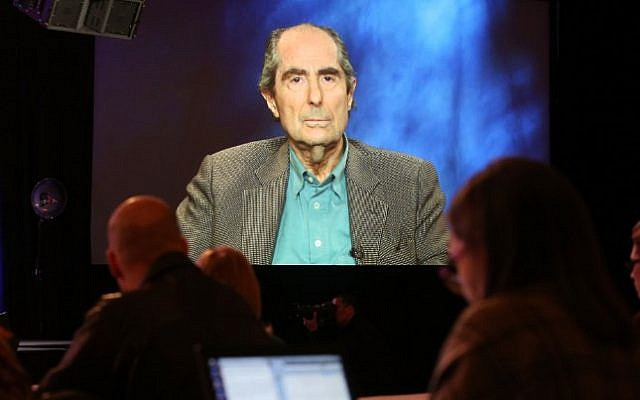 In this file photo taken on January 14, 2013, US novelist Philip Roth is projected onscreen as he speaks via satellite video feed to the audience during the PBS panel of 'American Masters Philip Roth: Unmasked' at the 2013 Winter Television Critics Association Press Tour at the Langham Huntington Hotel & Spa in Pasadena, California. (AFP PHOTO / GETTY IMAGES NORTH AMERICA / Frederick M. Brown)