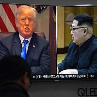 A man watches a television news showing North Korean leader Kim Jong Un, right, and US President Donald Trump, left, at a railway station in Seoul on May 24, 2018. (Jung Yeon-je/AFP)
