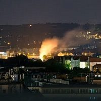 This picture taken during the night of May 23, 2018, shows a burning spot (C) on the site in Dresden, eastern Germany, where a World War II bomb was found and defused. (AFP PHOTO / dpa / Marco Klinger / Germany OUT)